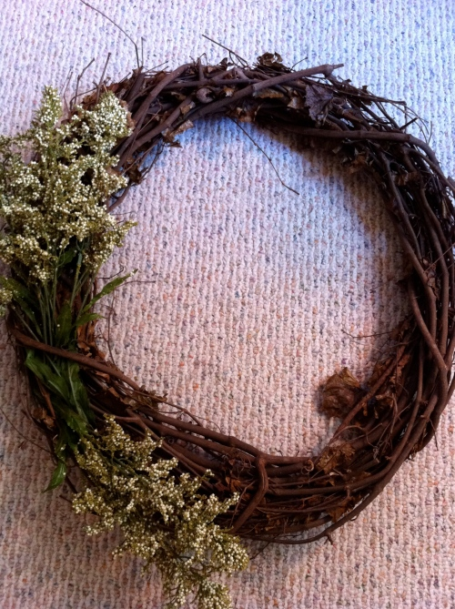 "cut ""earthy"" stems from bunch and stick the into grapevine wreath"