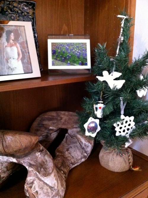 White ornament mini tree. (next to a vintage saddle that I <3 dearly)
